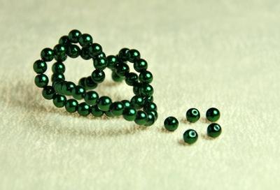 5010071  50 X Glasparel donker groen 4mm.